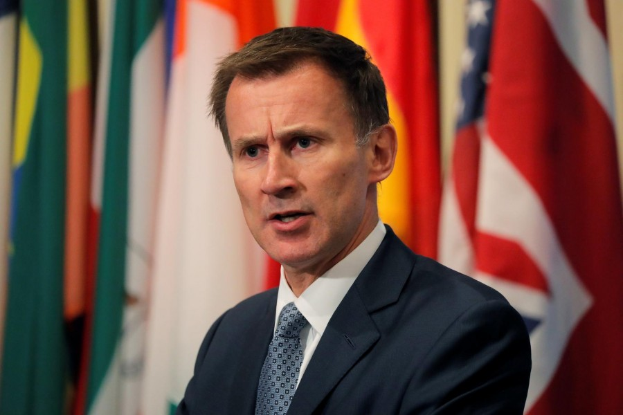 FILE PHOTO: British Foreign Secretary Jeremy Hunt speaks outside the United Nations Security Council prior to presiding over a meeting of the Council at UN headquarters in New York City, New York, US, August 23, 2018 - REUTERS/Lucas Jackson