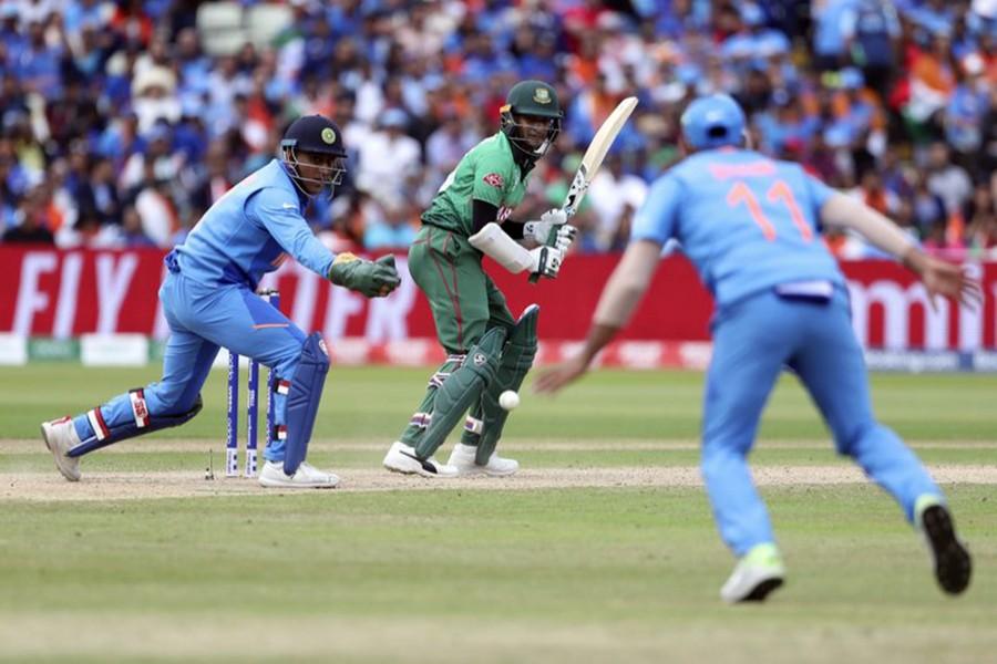 Bangladesh's Shakib Al Hasan, centre, bats during the Cricket World Cup match between Bangladesh and India at Birmingham's Edgbaston, England on Tuesday, July 2 — AP photo