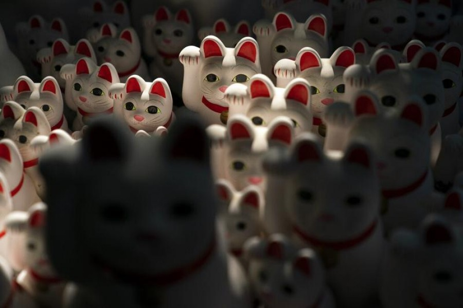 In this June 25, 2019, photo, beckoning cat figurines are on display at Gotokuji Temple in Tokyo - JAE C HONG/AP