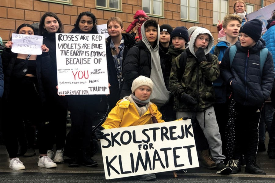 Swedish 16-year-old environmental activist Greta Thunberg (in the front) attends a protest next to Sweden's parliament in Stockholm, Sweden, on March 08, 2019. The sign reads 'School strike for the climate'. —Photo: Reuters 'A young Swedish girl, Greta Thunberg, has done more with her stubbornness to raise awareness about impending climate change than the entire political system. Even Trump (albeit for electoral reasons) has now declared that climate change is important.'