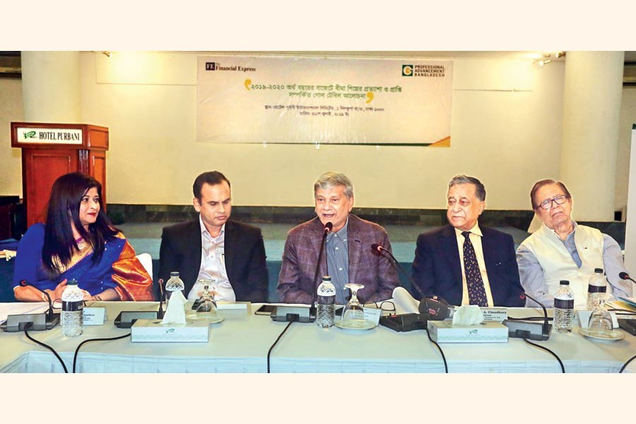 Planning Minister MA Mannan (centre) speaking at a roundtable on 'Budget for fiscal year 2019-20: Insurance industry's expectations and outcome' at a city hotel on Wednesday. Professional Advancement Bangladesh Limited Chairman Nasir A Choudhury (2nd, right), The Financial Express Editor Shah Husain Imam (extreme right), Insurance Development and Regulatory Authority member Dr Mosharraf Hossain (2nd, left) and MD and CEO of Green Delta Insurance Company Farzanah Chowdhury were also present — FE Photo
