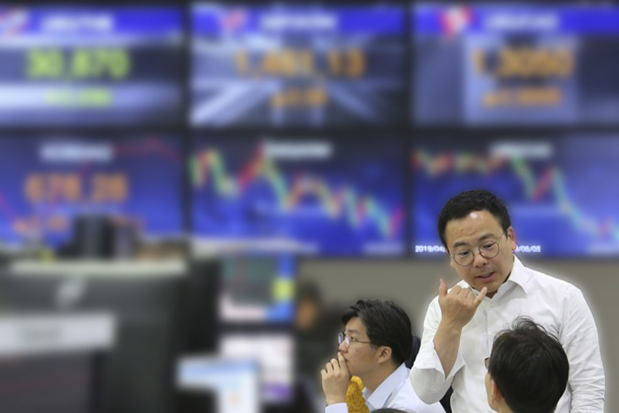 Asian shares rebound after volatile Wall Street day