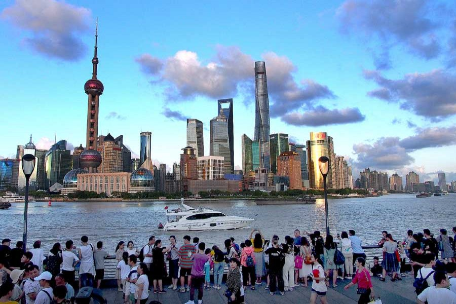 People visit the Bund in east China's Shanghai, Aug. 2, 2019. - Xinhua