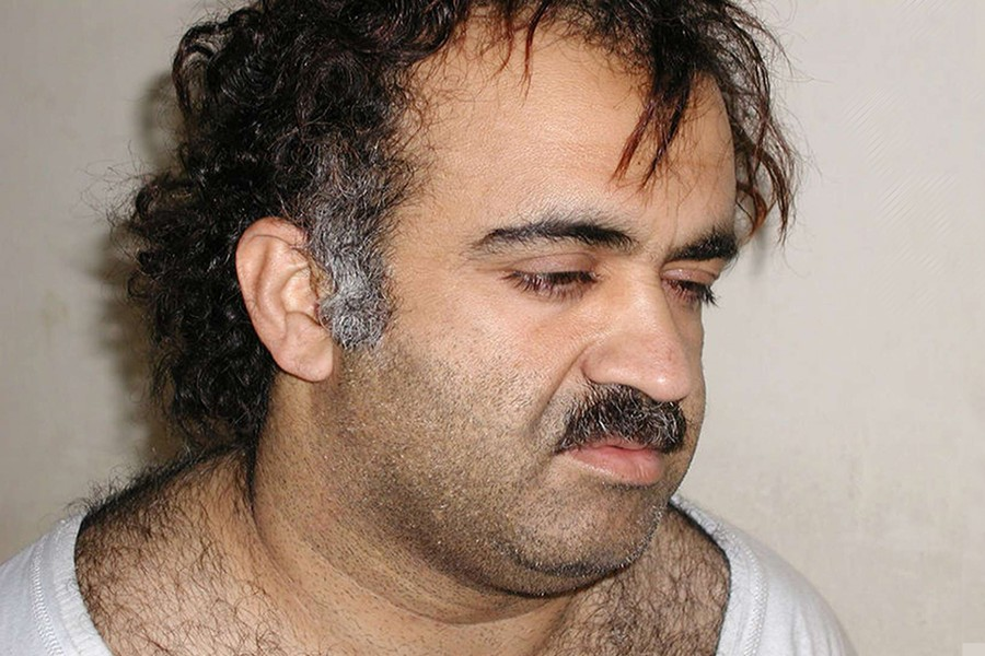 Khalid Sheikh Mohammed is shown in this photograph during his arrest on March 1, 2003 — Reuters/Courtesy US News & World Report HK/jm