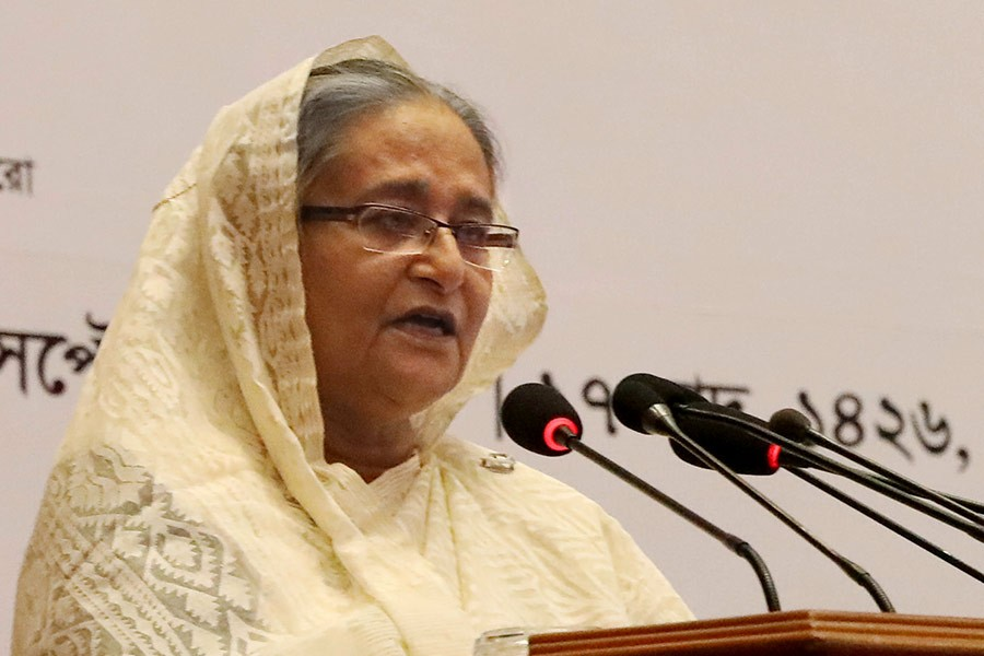Prime Minister Sheikh Hasina addressing a function on awarding the prestigious National Export Trophy 2016-17 in the city on Sunday. -PID Photo