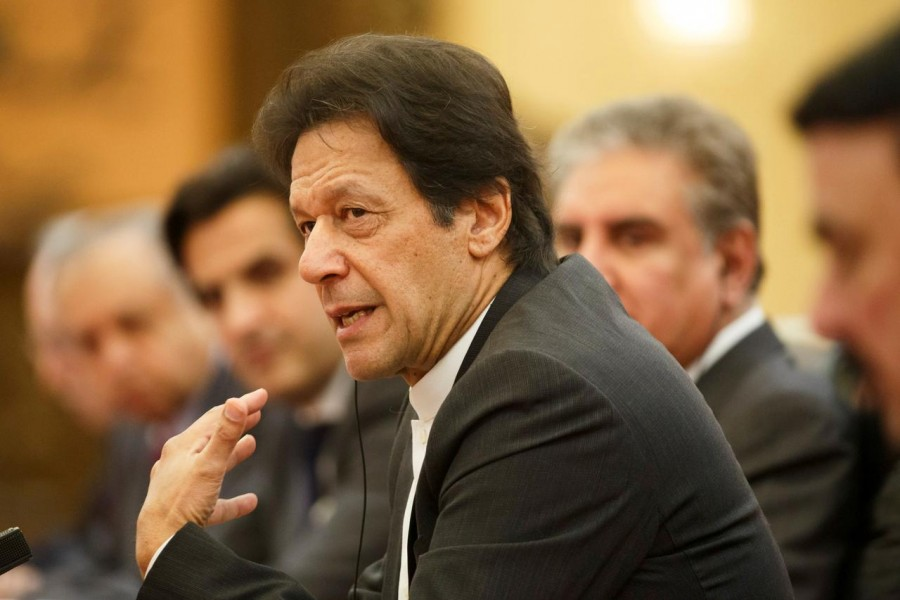 FILE PHOTO: Pakistani Prime Minister Imran Khan attends talks at the Great Hall of the People in Beijing, November 2, 2018. REUTERS/Thomas Peter/Pool/File Photo
