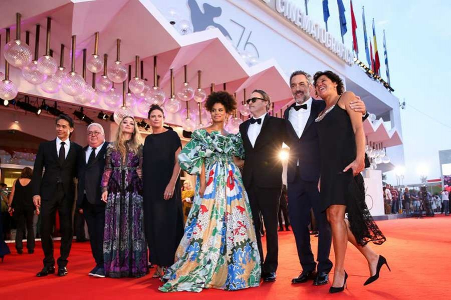 "Director Todd Phillips (2nd R) and other cast members pose on the red carpet for the premiere of the film ""Joker"" during the 76th Venice International Film Festival in Venice, Italy, Aug. 31, 2019. (Xinhua/Zhang Cheng)"