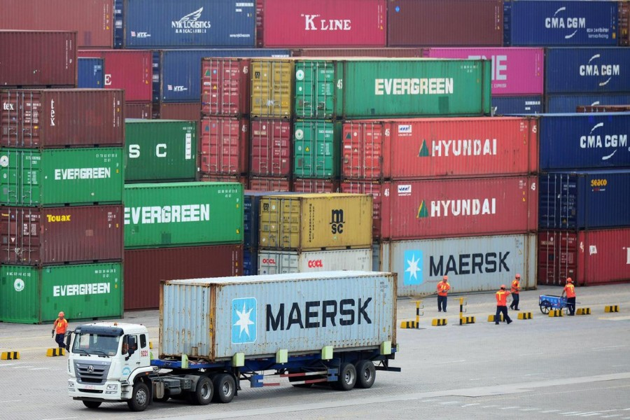 FILE PHOTO: A truck transports a container at a port in Qingdao, Shandong province, China July 11, 2019. REUTERS/Stringer