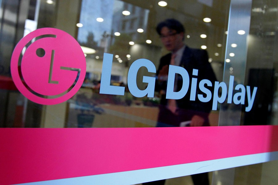 A man walks out of the headquarters of LG Display in Seoul on October 20, 2011 — Reuters/Files