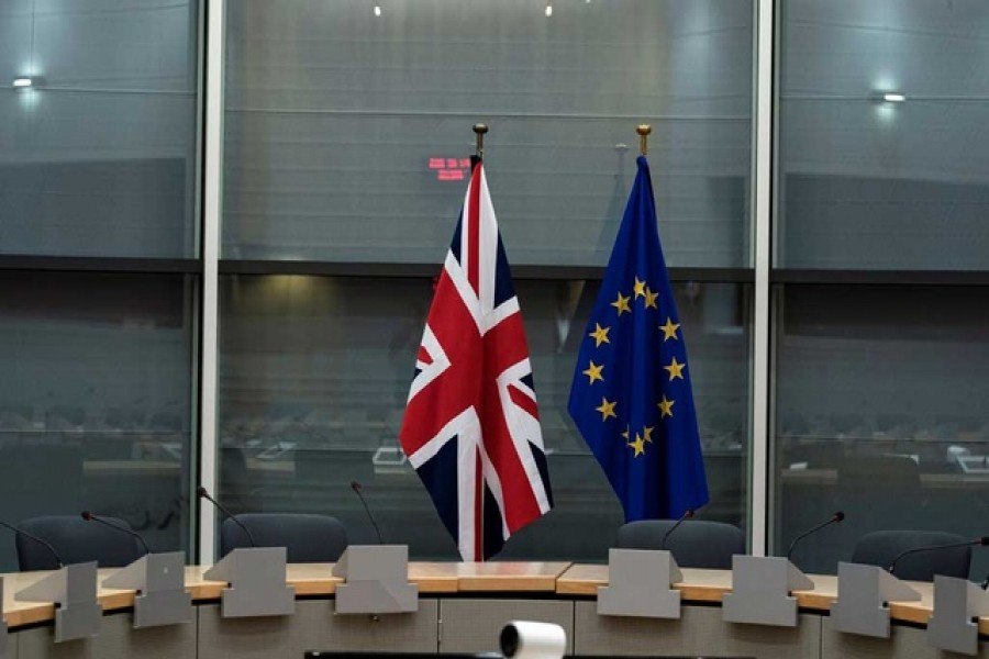 British Union Jack and EU flags are pictured before the meeting with Britain's Brexit Secretary Stephen Barclay and European Union's chief Brexit negotiator Michel Barnier at the EU Commission headquarters in Brussels, Belgium, September 20, 2019. Reuters