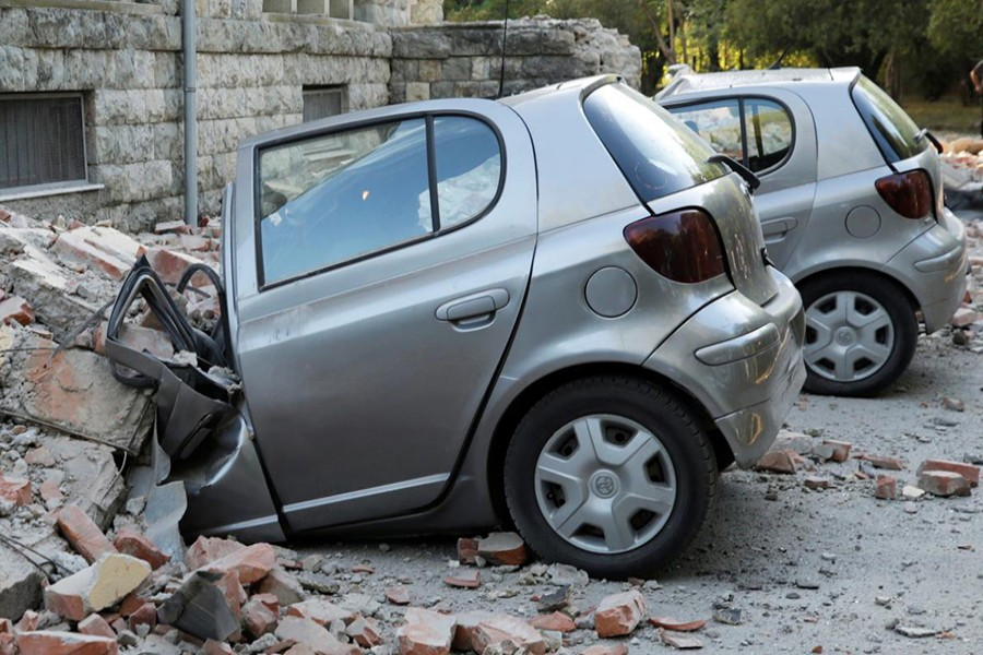 Destroyed cars stand next to a damaged building after an earthquake in Tirana, Albania on September 21, 2019 — Reuters photo