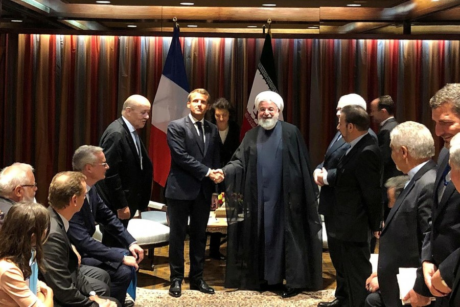 FILE PHOTO: French President Emmanuel Macron shakes hands with Iranian President Hassan Rouhani during their meeting on the sidelines of the United Nations General Assembly in New York, U.S., September 23, 2019. REUTERS/John Irish/File Photo