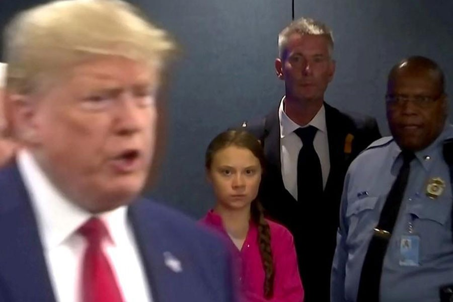 Swedish environmental activist Greta Thunberg watches as U.S. President Donald Trump enters the United Nations to speak with reporters in a still image from video taken in New York City, U.S. September 23, 2019. REUTERS/Andrew Hofstetter