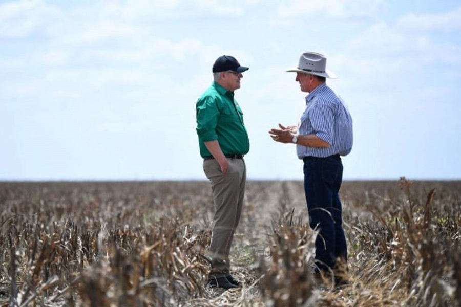 Australian Prime Minister Scott Morrison chats with farmer David Gooding on his drought-affected property near Dalby, Queensland, Australia, September 27, 2019. (Photo- AAP)