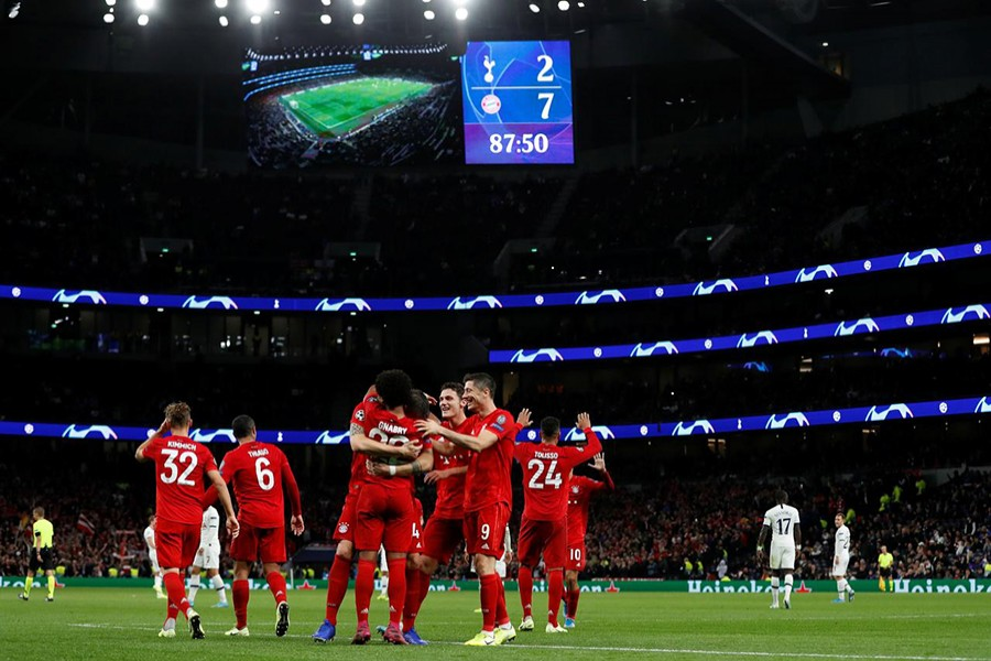 Bayern Munich's Serge Gnabry celebrates scoring their seventh goal with teammates — Reuters action image