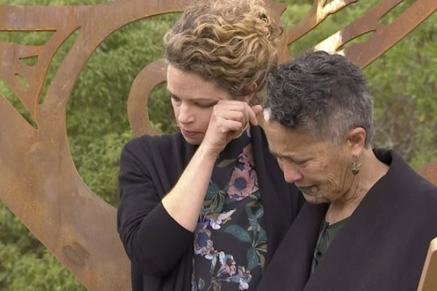 British High Commissioner Laura Clarke, left, wiping her tears after hugging a Maori elder, right, when she visited the town of Gisborne, New Zealand, Wednesday. -AP Photo