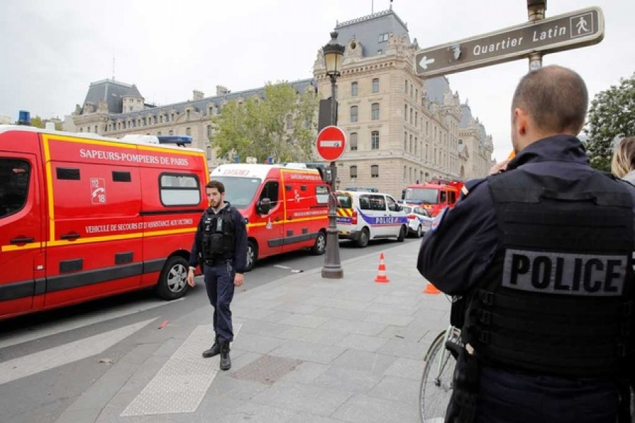 Knife attack by employee at Paris police HQ kills four officers