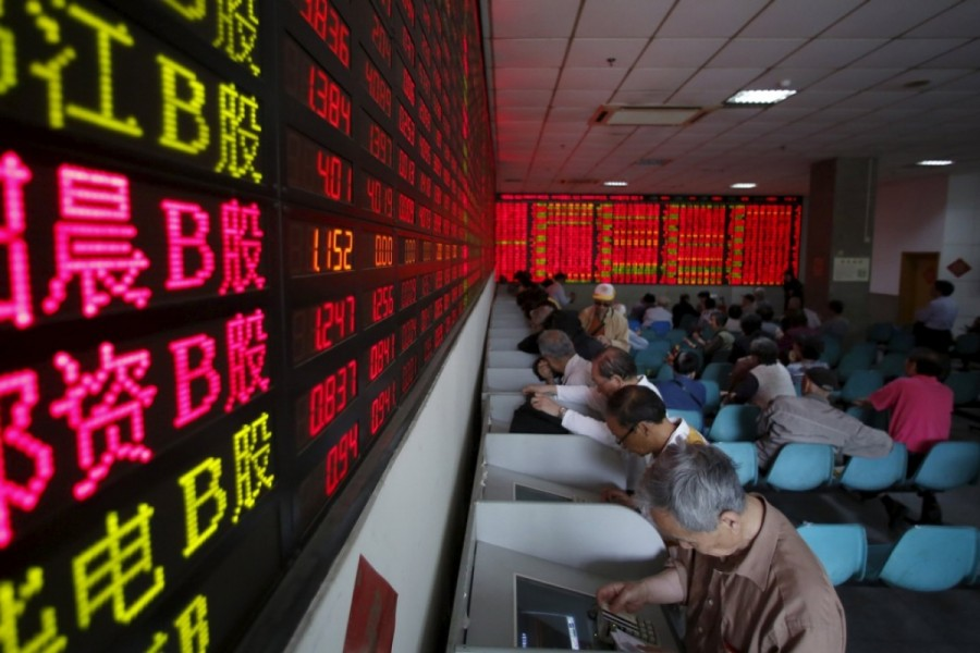 Investors tracking stock information at a brokerage house in Shanghai. Photo: Reuters