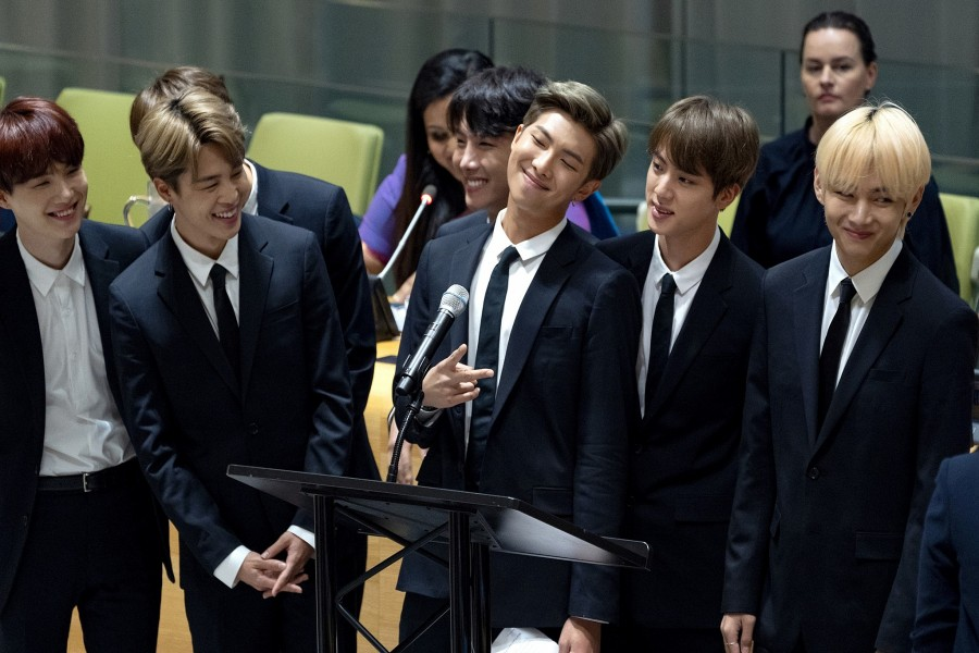 In this September 24, 2018, file photo, members of the Korean K-Pop group BTS attend a meeting at the United Nations high-level event on youth during the 73rd session of the United Nations General Assembly at UN headquarters. (AP Photo/Craig Ruttle, File)