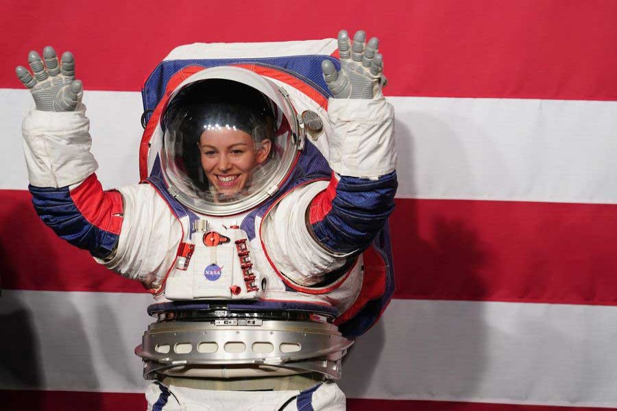Advanced Space Suit Engineer Kristine Davis displays the Exploration Extravehicular Mobility Unit (xEMU) spacesuit at NASA headquarters in Washington DC, the United States, on Oct. 15, 2019. (Xinhua/Liu Jie)