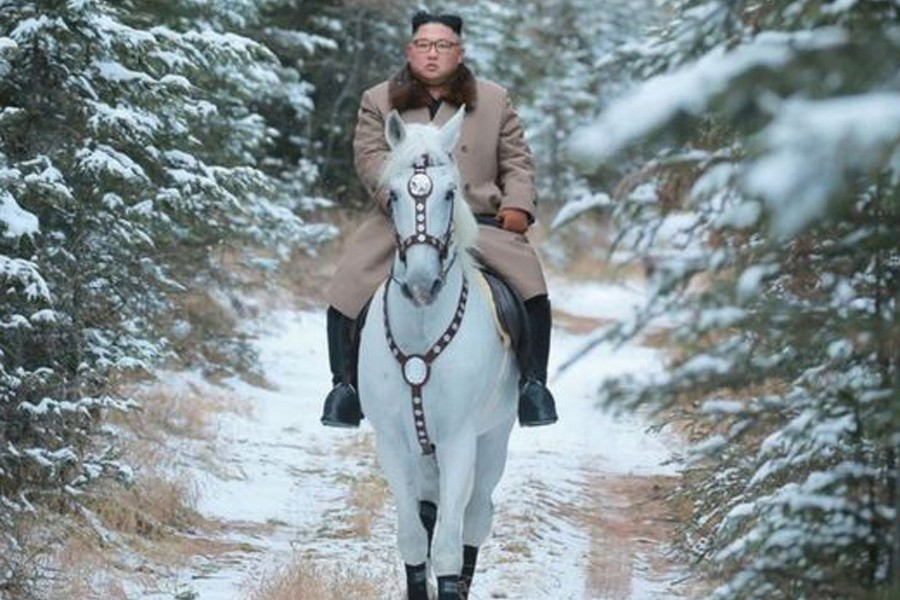 N Korean leader Kim Jong-un riding a white horse on a snow-covered Mount Paektu  	— Reuters