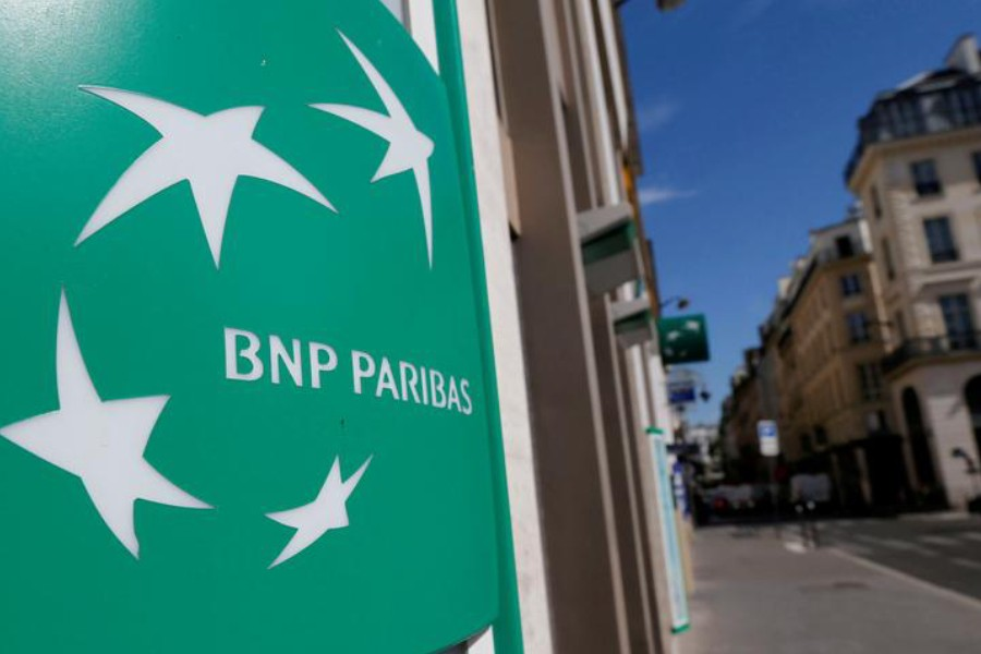 FILE PHOTO: A BNP Paribas logo is seen outside a bank office in Paris, France, August 6, 2018. REUTERS/Regis Duvignau/File Photo