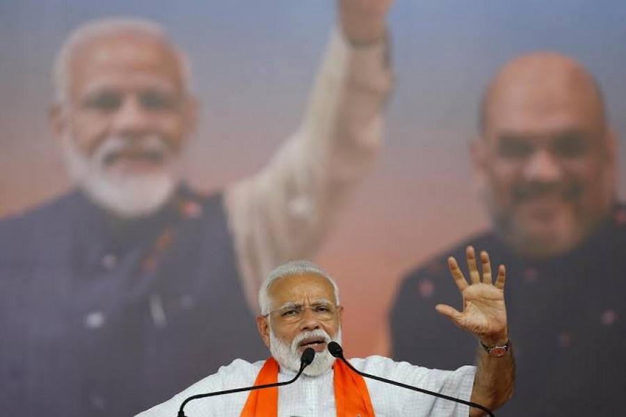 FILE PHOTO: India's Prime Minister Narendra Modi gestures as he addresses his supporters during a public meeting in Ahmedabad, India, May 26, 2019. REUTERS/Amit Dave