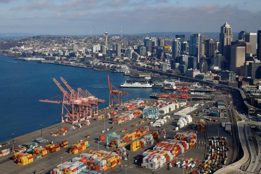 An aerial photo looking north shows shipping containers at the Port of Seattle and the Elliott Bay waterfront in Seattle, Washington, US March 21, 2019. Reuters/Files