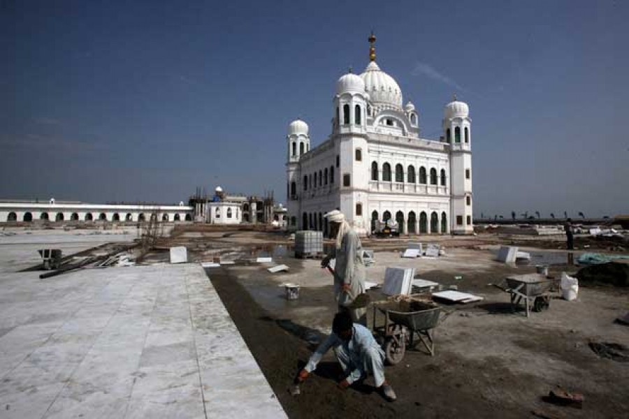 Labourers work at the sites of the Gurdwara Darbar Sahib, which will be open this year for Indian Sikh pilgrims, in Kartarpur, Pakistan Sep 16, 2019. REUTERS