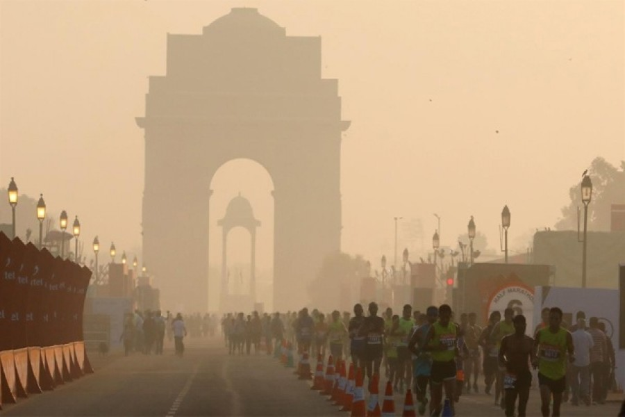 Participants run past the India Gate as they take part in the Airtel Delhi Half Marathon in New Delhi, India, Oct 20, 2019. REUTERS