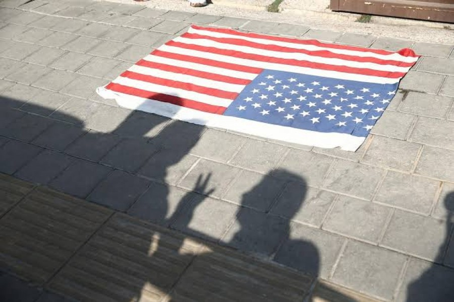 A flag of US is seen on the ground in front of former US embassy in Tehran, Iran November 2, 2019. Nazanin Tabatabaee/WANA (West Asia News Agency) via REUTERS