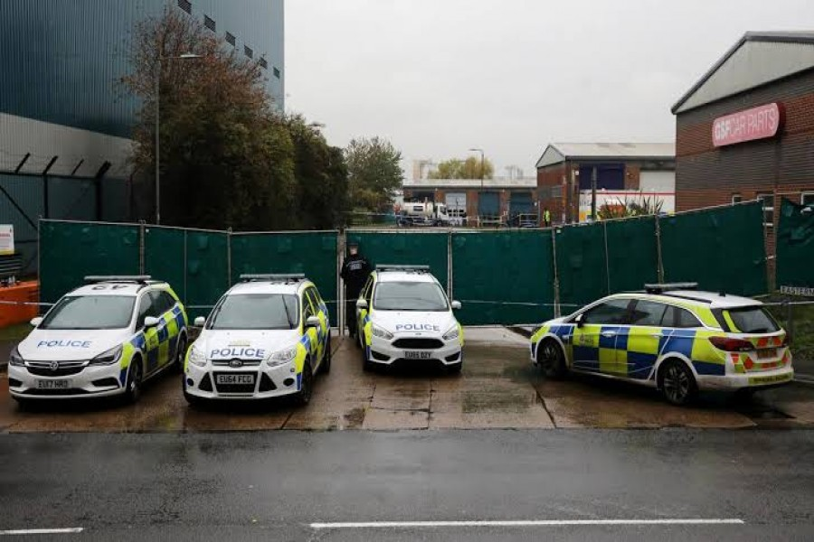 FILE PHOTO: Police vehicles are seen at the scene where bodies were discovered in a lorry container, in Grays, Essex, Britain October 24, 2019. REUTERS/Simon Dawson
