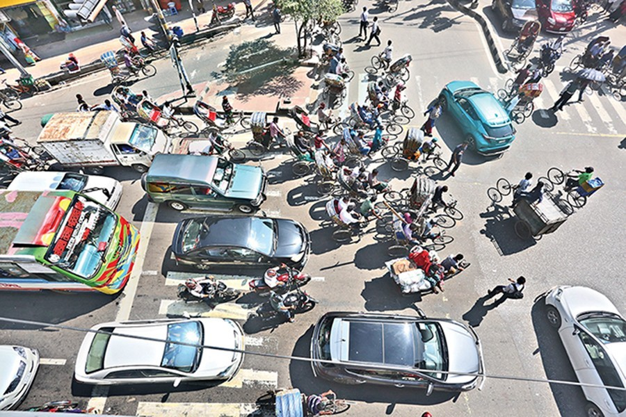 Traffic rules continued to be violated on the second day of enforcement of Road Transport Act, 2018. The photograph of different vehicles blocking pedestrians' movement through the zebra crossing was taken from Shantinagar in the city on Saturday — FE photo