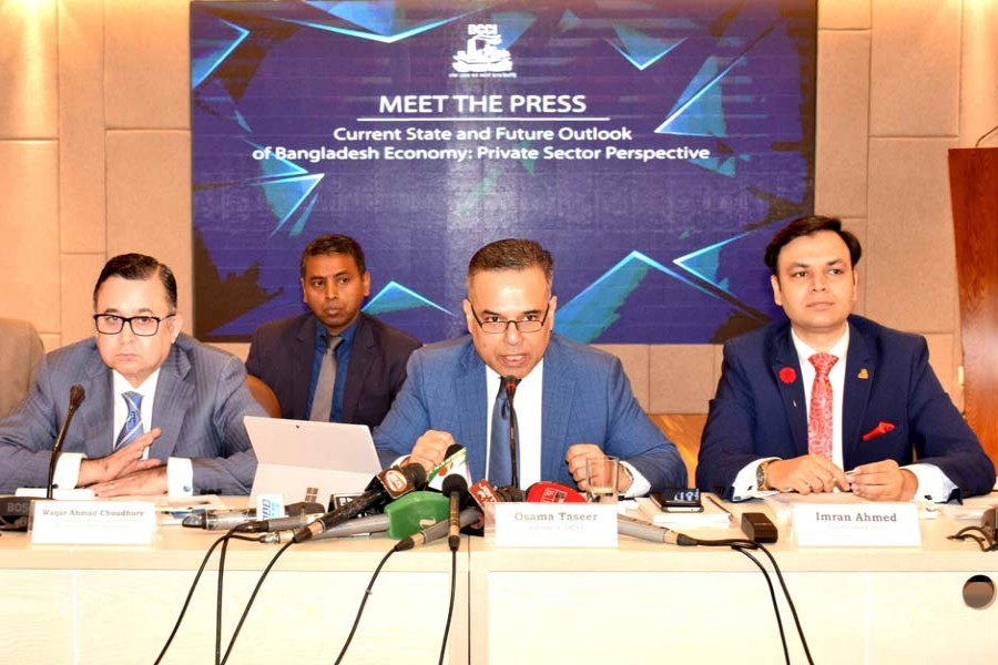 """DCCI President Osama Taseer (second from right) speaking at a Meet the Press on """"Current State and Future Outlook of Bangladesh Economy: Private Sector Perspective"""" held on November 09, 2019 at DCCI Auditorium. DCCI Senior Vice President Waqar Ahmad Choudhury (left), Vice President Imran Ahmed (right) and members of the board of directors were present during the event"""