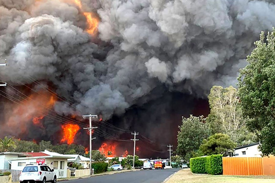 Australian firefighters battle blazes, brace for more