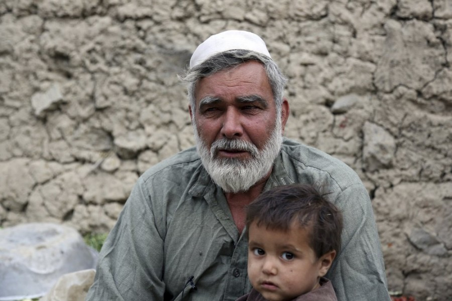 In this Oct. 29, 2019 photo, Yusouf, who escaped war in eastern Afghanistan to safeguard his family, speaks during an interview in Kabul, Afghanistan. In the capital, Kabul, five of his children died, not from violence or bombings, but from air pollution, worsened by bitter cold and poverty. (AP Photo/Rahmat Gul)