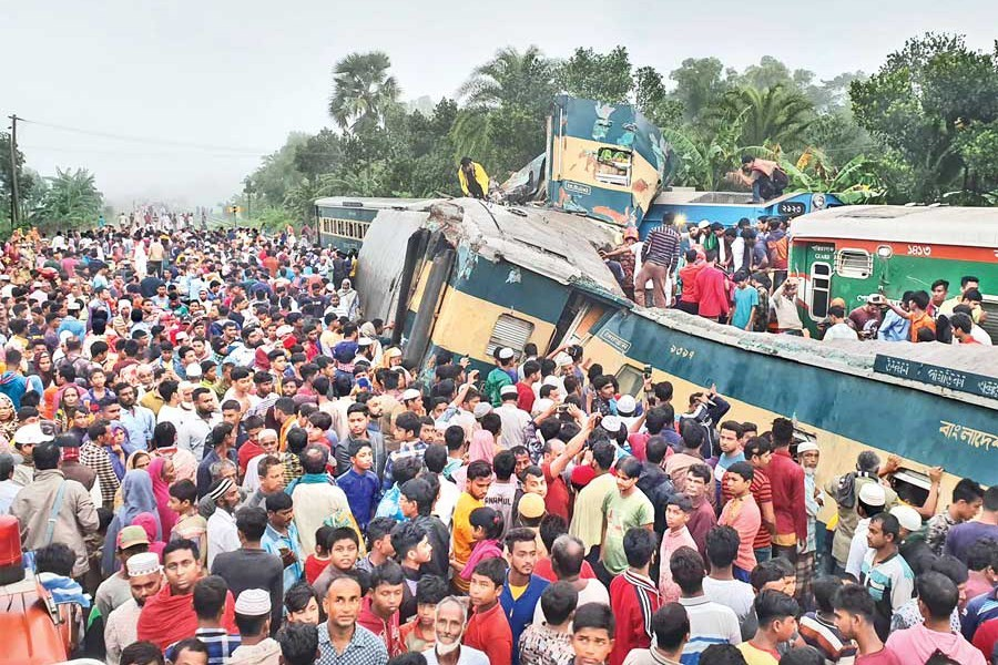 People gather around mangled wreckage of two trains that collided at a railway crossing near Mandabag Railway Station in Kasba upazila of Brahmanbaria in the early hours of Tuesday — Focus Bangla