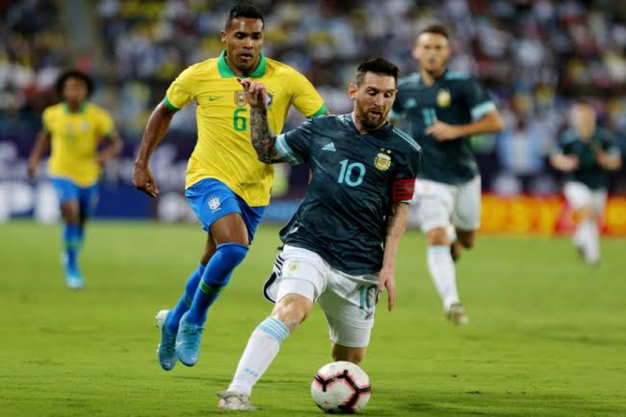 International Friendly - Brazil v Argentina - King Saud University Stadium, Riyadh, Saudi Arabia - November 15, 2019 Argentina's Lionel Messi in action with Brazil's Alex Sandro REUTERS/Ahmed Yosri