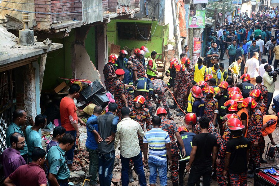 Firefighters work at the site of an explosion which occurred at a house in Chattogram's Patharghata area on Sunday morning — Reuters photo