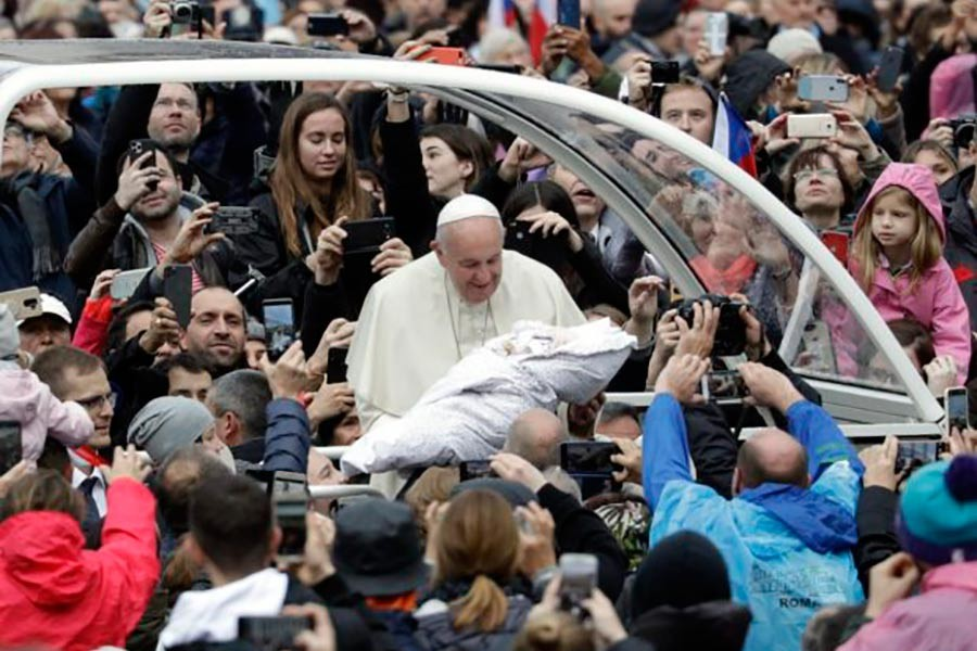 Pope Francis is given a newborn baby to bless as he arrives for his weekly general audience in St. Peter's Square, at the Vatican, Wednesday, Nov. 13, 2019. -AP Photo