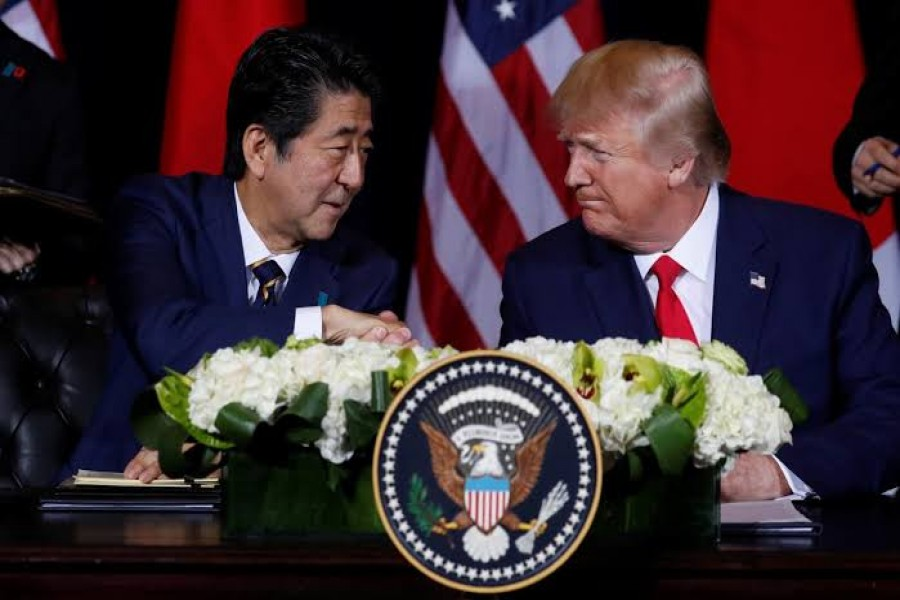 Japan's Prime Minister Shinzo Abe shakes hands with US President Donald Trump during a signing ceremony on the sidelines of the 74th session of the United Nations General Assembly (UNGA) in New York City, New York, US, September 25, 2019. Reuters/File Photo