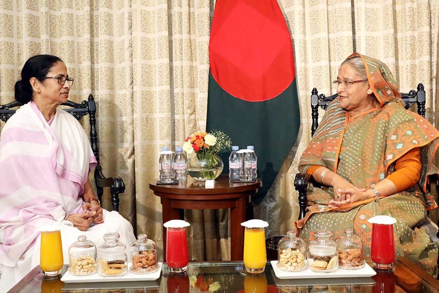 Chief Minister of India's West Bengal State Mamata Banarjee paying a courtesy call on Bangladesh Prime Minister Sheikh Hasina on Friday at a hotel in West Bengal. -PID Photo