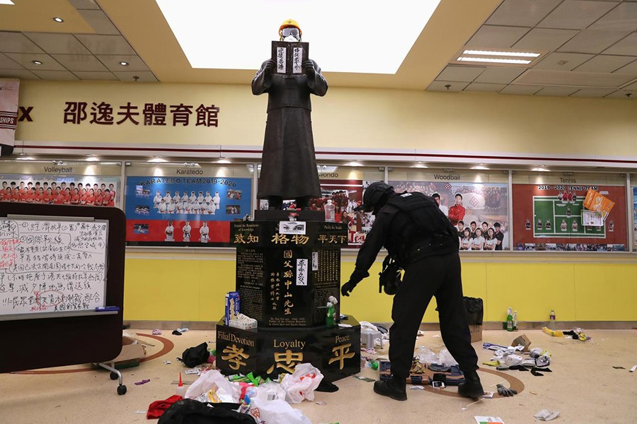 Member of a safety team established by police and local authorities inspects around a statue of Dr Sun Yat-sen, as they assess and clear unsafe items at the Hong Kong Polytechnic University (PolyU) in Hong Kong, China on November 28, 2019 — Reuters photo