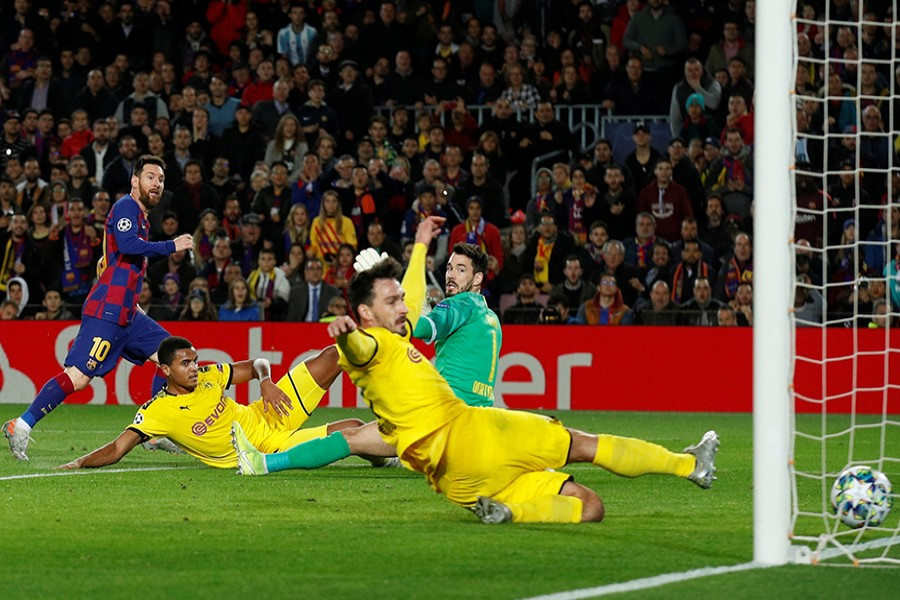 Barcelona's Lionel Messi scores their second goal against Borussia Dortmund — Reuters photo