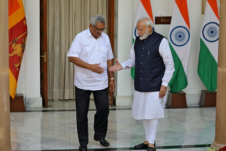 Sri Lanka's President Gotabaya Rajapaksa and India's Prime Minister Narendra Modi shaking their hands during a photo opportunity ahead of their meeting at Hyderabad House in New Delhi, India on Friday. -Reuters Photo