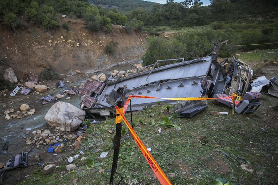 The debris of a regional bus that crashed off a hill are pictured on Sunday, December 1, 2019, causing the death of at least 24 passengers who were on an excursion in the Amdoun region, northern Tunisia — AP photo