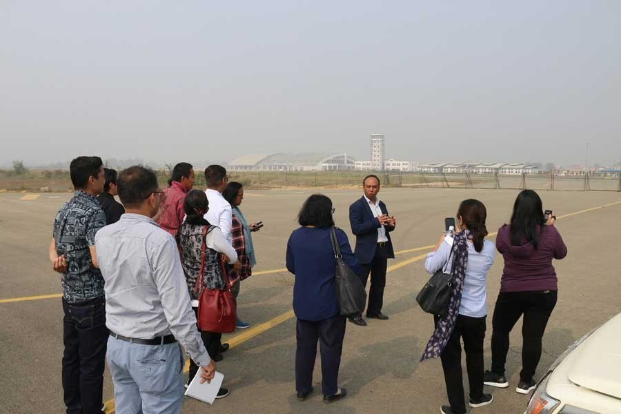 Naresh Pradhan, senior project officer (transport) at ADB's Nepal Resident Mission, briefing a media team on the newly constructed runway of Goutam Buddha International Airport (GBIA) at Bhairahawa, Nepal recently