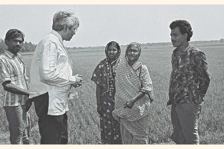 Brac founder Sir Fazle Hasan Abed talking to some of the NGO's beneficiary farmers during a field visit. —Photo: Brac