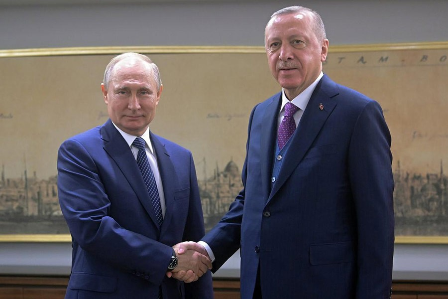 Turkish President Tayyip Erdogan shaking hands with his Russian counterpart Vladimir Putin during a meeting in Istanbul, Turkey on Wednesday. -Reuters Photo