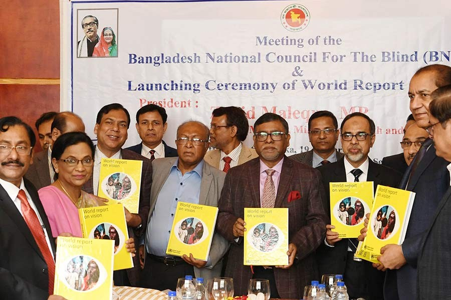 Health Minister Zahid Maleque unveiling the cover of a report, titled World Report on Vision, at a city hotel on Sunday. -PID Photo